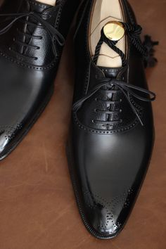 Black dress shoes are your best bet for a funeral. Leave the sneakers, boots, loafers and sandals at home. #loveliveson