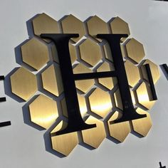 Bound to make a Buzz!Brushed brass and painted aluminum for the hivery of mill valley. Built to last the longterm! Sign Maker, Metal Plaque, Letter B, Honeycomb, Cube, Wall Lights, Instagram Posts, Prints, Branding