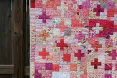 I feel such satisfaction in a good scrap quilt.  I started these pink plus blocks because my pink scrap bin was overflowing.  I probably ...