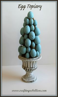 Tutorial to make this Egg Topiary: love the Tiffany blue and eggs and rustic white stand!