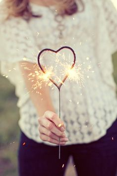 heart shape sparklers..perfect for weddings (perspective shot of bride and groom within the heart as its sparking)