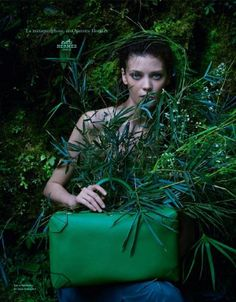 Hermes Spring / Summer 2014 Ad Campaign continues jungle theme from Show.  Diana is pictured holding a Hermes 'Maxibox' in Veaux Evercolor a gorgeous deep turquoise amongst whimsical greenery.