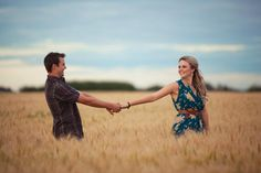 golden field engagement photo.