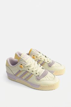 Shop adidas Originals Rivalry Lilac Low Trainers at Urban Outfitters today. Sneakers Fashion, Fashion Shoes, Shoes Sneakers, Leather Sneakers, High Top Sneakers, Adidas Shoes Women, Adidas Jeans Shoes, Adidas Sneakers, Adidas Retro