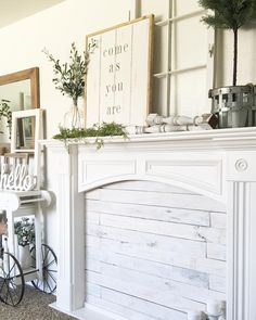 Faux fireplace using old wood and a thrifted mantle.