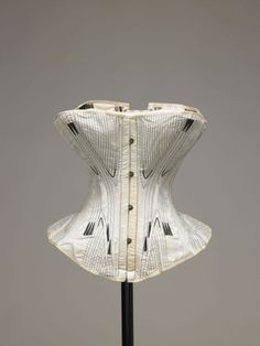 Pale green watered silk corset, ca. 1850s | In the Swan's Shadow