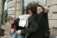 Protesters attack an LGBT activist during a St. Petersburg, Russia event in June 2013.