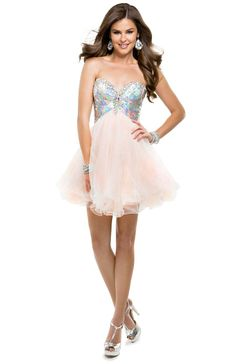 This tulle, babydoll mini calls for seriously bronzed legs, though we can't guarantee any attention diverted from the fully beaded, piette bodice!   #flirtprom #P4883 #pink #blush #promdress