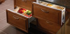Here's a plan: instead of one big refrigerator, multiple refrigerator and freezer drawers in various areas of the kitchen hold specific items used in that area. Sandwich drawer. Salad drawer. Fruit drawer. Canned/boxed drinks drawer. Freezer drawer for convenience-type foods and chocolate popsicles!