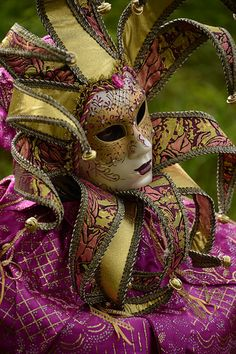 magenta reveler at the Carnival, Venice (by Kevin Clausse)