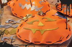 """pumpkins, """"sewing"""" with ribbon, sticky-backed craft foam for faces, stuff with newspaper. So cute."""