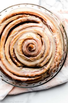 Learn how to make a GIANT cinnamon roll cake using an easy shortcut homemade cinnamon roll dough and swirling it into one large cake. Top with vanilla icing for a fun and indulgent breakfast and brunch. Recipe on sallysbakingaddiction.com