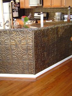 Tin ceiling panels --We did a backslash in my parents house with copper ones--very cool. #Kitchen