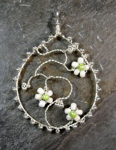 I think I could improve on the shape of the 'vine'.  Sterling silver wire and 2mm beads, with glass seed beads.  Not a very good pic!