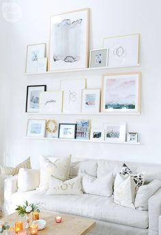 Pretty gallery wall, with Holiday accents, via Style at Home Magazine