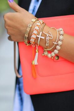 Coral clutch and stacked bracelets.