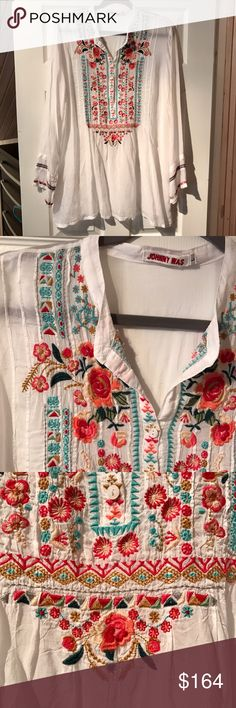 Johnny Was White Embroidered Blouse Long-Sleeves Johnny Was Collection white embroidered blouse has amazingly detailed aqua, red, peach, cream, gold and blue details. The shirt is 100% rayon and size large. It's never been worn, but has the tiniest run on the back upper neck line that would never be noticed. See the last photo. Johnny Was Tops Blouses