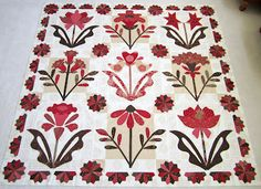 A applique quilt by Blackbird Designs, called Evening Bloom.  Love applique quilts!