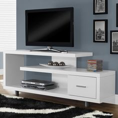 "TV Entertainment Center Modern Stand Contemporary Cabinet White Console 60 inch. Constructed with thick sturdy paneling. Accommodates up to a 47"" flat panel TV with side and bottom shelving space for audio visual components. Great addition to a living room, family room, media space, den. Dimensions:24""x16""x60""(HxWxL). Materials:Particle board,MDF ,Laminate."