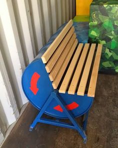 Oil Drum Outdoor Bench: An old oil drum is transformed into a rotating outdoor bench. Golf balls are filled inside of the drum to keep the seat steady when not in use.