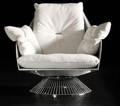 Gloss swivel armchair Outer shell in polyurethane resin. Metallic grey colour. Swivel chromed base and leathering covering. Design Giuseppe Viganò.