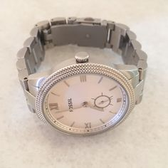 Fossil Watch Beautiful stainless steel fossil watch. Has been worn but is in great condition. I had links taken out to fit my 5 inch wrist. NEEDS BATTERY. No box. Fossil Accessories Watches
