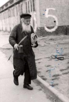 Wetzlar, Germany, Rabbi Issac Hertzberg on his way to synagogue during Sukkot in the DP camp, postwar.