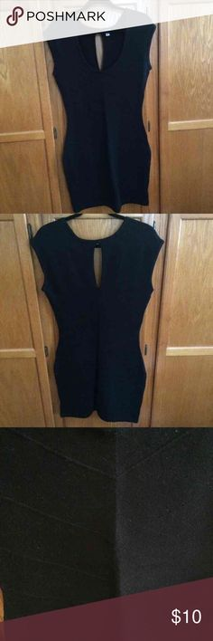 NWOT Guess sweater dress New without the tag. Black sweater dress with a cutout at the back of the neck. Front has a v neck. Raised downward arrow stitching over the dress Guess Dresses