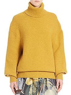 "Adam Lippes Solid Turtleneck Sweaterolid turtleneck sweater in blended cashmere fabric Turtleneck Drop shoulders Long sleeves with ribbed closure Pullover style About 25"" from shoulder to hem Cashmere/elastane Dry clean gold"