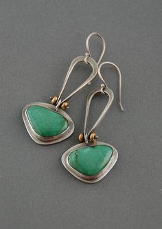 I love the color on these turquoise stones! They have an overall blue/green color, with just a hint of brown matrix. I have bezel set them in fine and