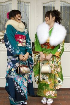 Seijinshiki - Coming of age in Japan (20) The girls are wearing the traditional kimonos and white fur stoles (it is winter and often snowy on that day) but modern touches and takes are happening.