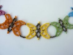 DIY Jewelry: FREE beading pattern for colorful and lacy butterfly necklace made entirely of 11/0 seed beads using netting techniques.