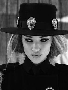 Love everything, the eyes, the hat, the high collar, the lapels. Everything