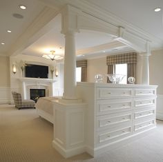 built-in dresser with back that serves as the headboard for the bed