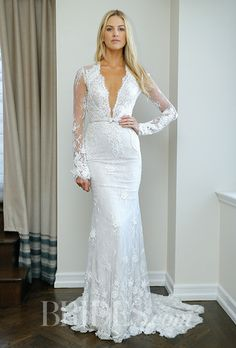 A lace @bertabridal wedding dress with a plunging V-neck | Brides.com