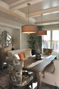 Formal dining with a bench sofa and orange accents