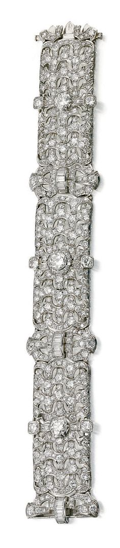 DIAMOND BRACELET, BULGARI,  CIRCA 1930.  The articulated band of open work geometric design, set with circular-, single, brilliant-cut and baguette diamonds,unsigned, length approximately 195mm, accompanied by a letter of authentificatuion and an original case signed Bulgari Roma.