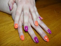 Sister's nails!  Done with Sinful Colors Summer Peach and Sinful Colors Dream On, with China Glaze Techno over top.