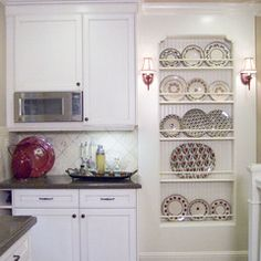 Plate rack...good use of space in a tiny house kitchen.