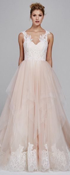 Blush pink lace and tulle wedding dress from @kellyfaetanini