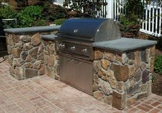 stone patio with built in BBQ | ... barbeque built on the side of their patio the barbeque itself is a