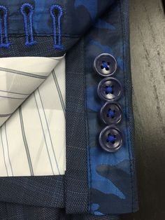 Camo lining inside of a Navy windowpane b.spoke suit made with Guabello fabric. Get yours at www.bspokestyle.com