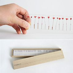 Japanese designer Norihiko Terayama of Studio Note /   Each acrylic ruler consists of 28 dried flowers with red-dyed stems, meticulously placed 1 cm apart from each other