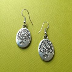 Tree of Life Earrings.  Three designs on my website. www.angryhippiejewelry.com Jewelry doesn't have to be expensive to be beautiful.