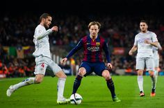 Mario Suarez of Club Atletico de Madrid plays the ball next to Ivan Rakitic of FC Barcelona during the Copa del Rey Quarter-Final First Leg match between FC Barcelona and Club Atletico de Madrid at Camp Nou on January 21, 2015 in Barcelona, Catalonia.