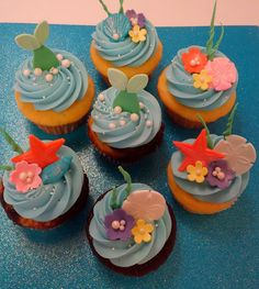 Here are some Little Mermaid themed cupcakes I made for a birthday. The Ariel and Flounder are made out of decorating chocolate and th. Little Mermaid Cupcakes, Sea Cupcakes, Disney Cupcakes, Themed Cupcakes, Yummy Cupcakes, Cupcake Cakes, Mermaid Birthday Cakes, Little Mermaid Birthday, Little Mermaid Parties