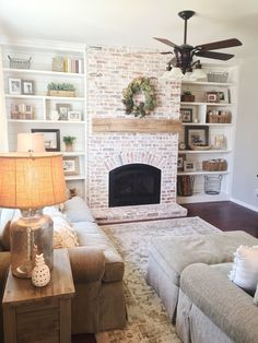 Built-in bookshelves, shiplap, whitewash brick fireplace, rustic mantle