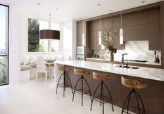 Find Modern Designing Home Decorating Inspiration for New Home : Excellent Kitchen Room Design With Brown Kitchen Cabinet And White Granite Kitchen Table Top And Kitchen Bar Stools