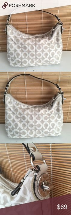 NWOT coach mini bag monogram NWOT coach mini bag with grey and white tones and silver hardware. In excellent, never carried condition. Truly a beautiful bag. JH1822 Coach Bags Mini Bags