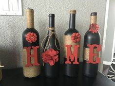 Love this one of a kind set. Black chalk paint on the wine bottles with wooden letters painted a fabulous red and flowers spell out the word home. Accents of red add to the look of this piece.